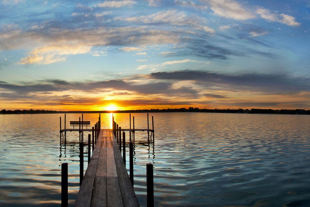 sunrose over a dock on a lake offers a feeling of healing and restoration